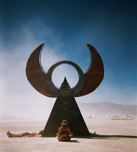 A worshiper praying to her pagan god, Osiris, at Burning Man 2013